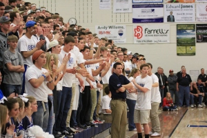 The Coliseum Crazies show off their Titan spirit by wearing all white.